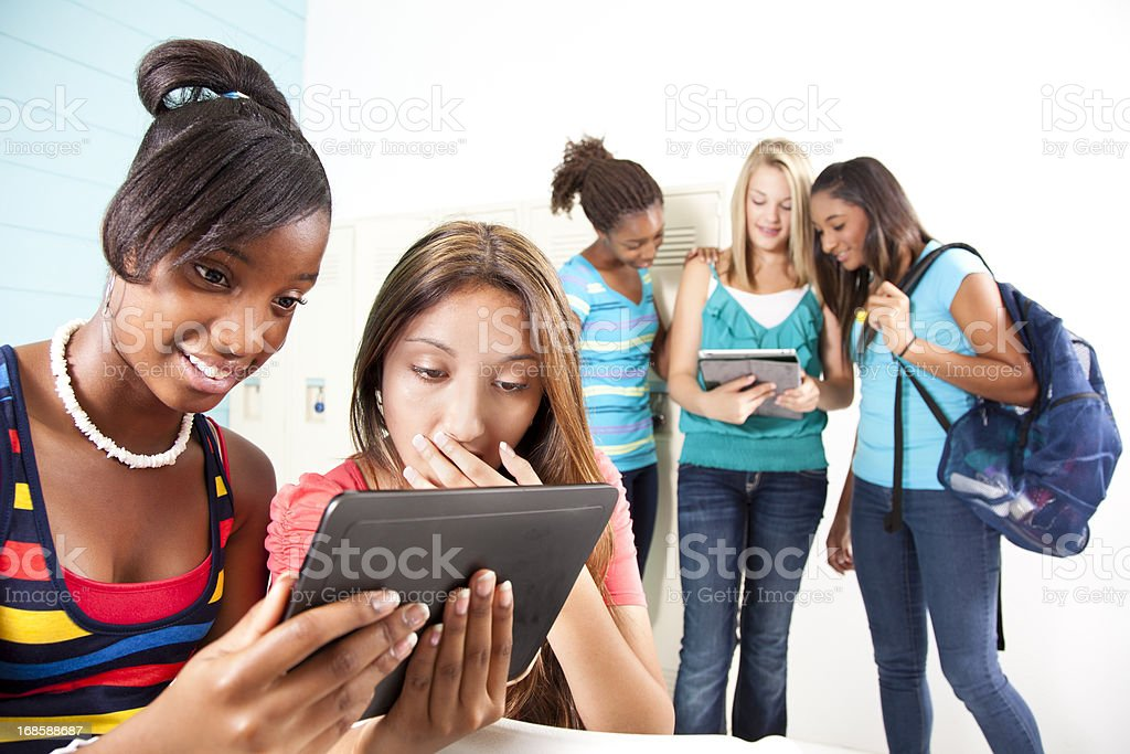 Five teenage girls looking digital tablet. Social networking. Mobile device. royalty-free stock photo