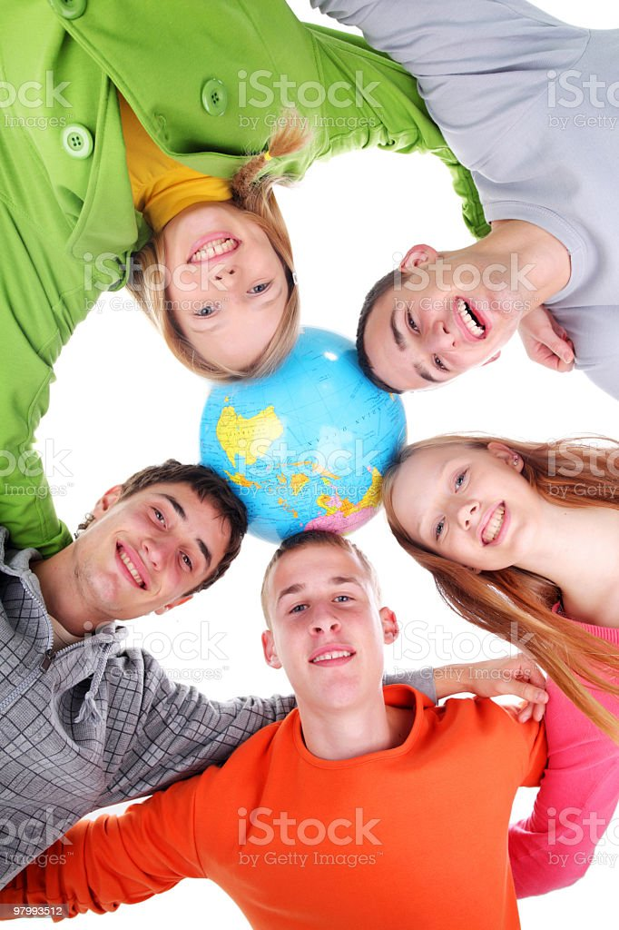 Five teenagers with a globe looking at camera. royalty free stockfoto
