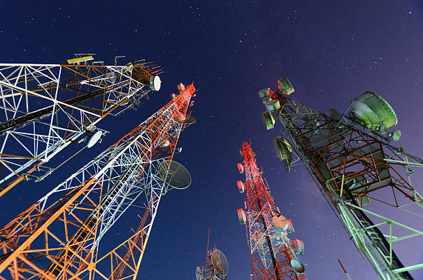 Five telecommunication towers under a night sky  stock photo