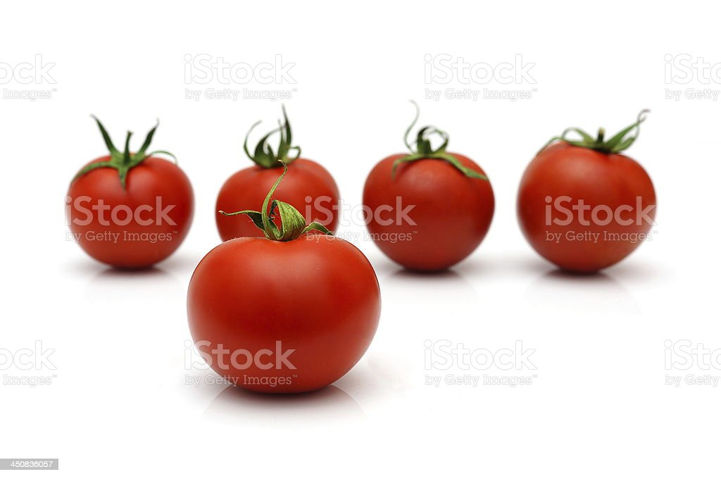 five tomatoes with four in blur royalty-free stock photo
