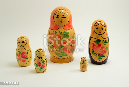 five traditional Russian nesting dolls on white background