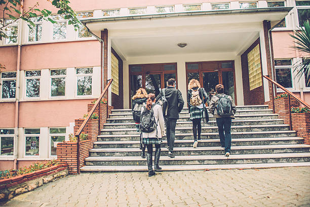 Five Turkish Students Going to School, Istanbul Five Turkish students walking to school. They are ascending the staircase, outdoors, campus. Cold autumnal morning. Nikon D800, full frame, XXXL. high school building stock pictures, royalty-free photos & images