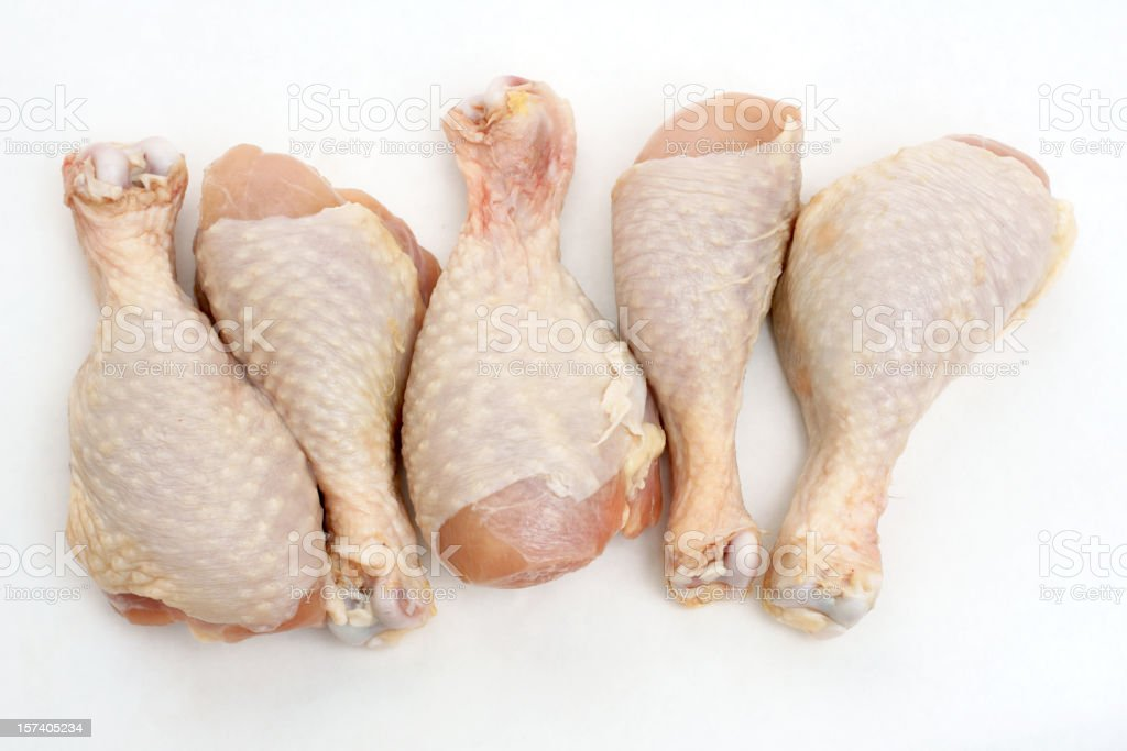 five uncooked chicken drumsticks royalty-free stock photo