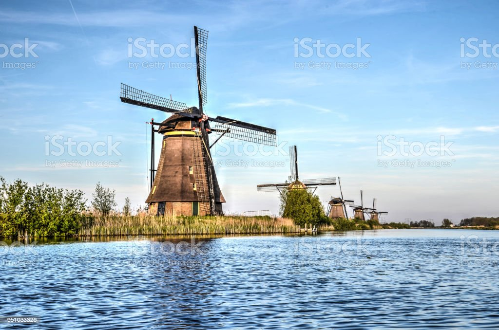 Five windmills in a row stock photo