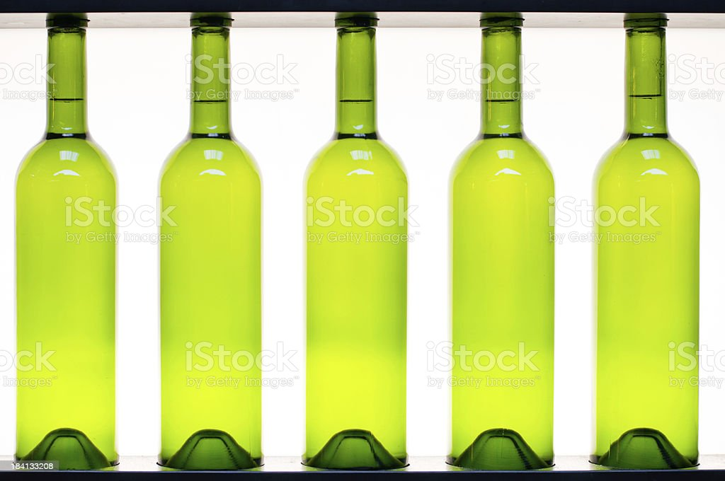 Five wine bottles in a row royalty-free stock photo