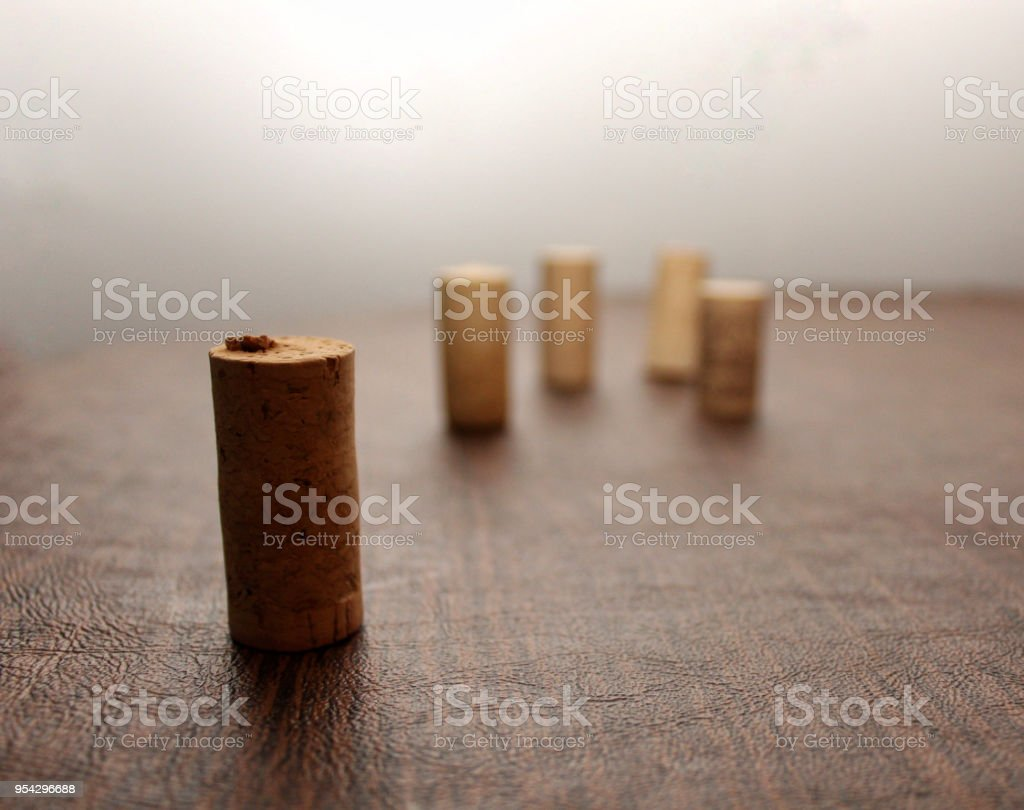 Five Wine Corks staggered on a wooden table stock photo