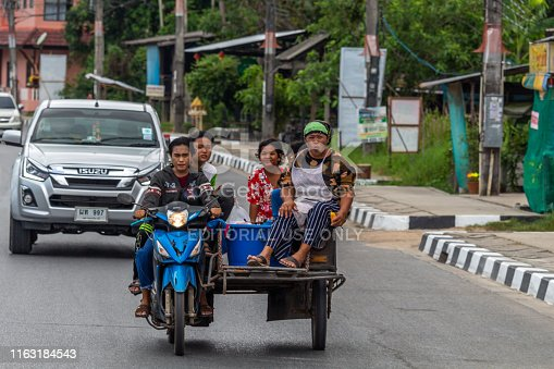 Koh Samui, Thailand - April 16, 2019: Five women on a sidecar on the streets of Samui island