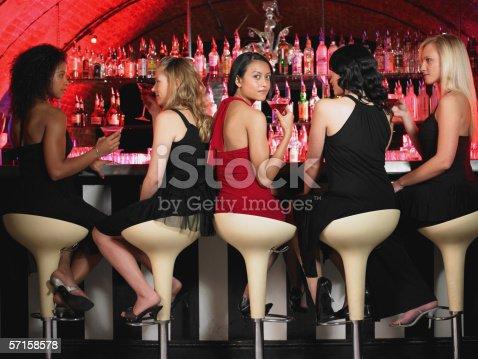 istock Five women sitting at bar 57158578