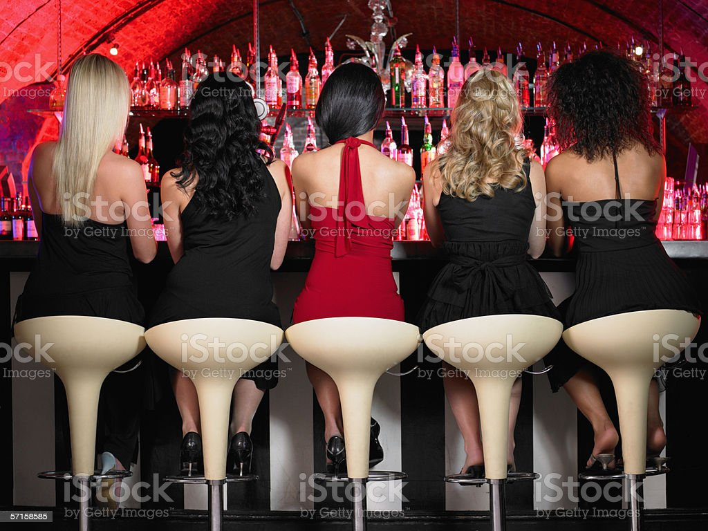 Five women sitting at bar stock photo
