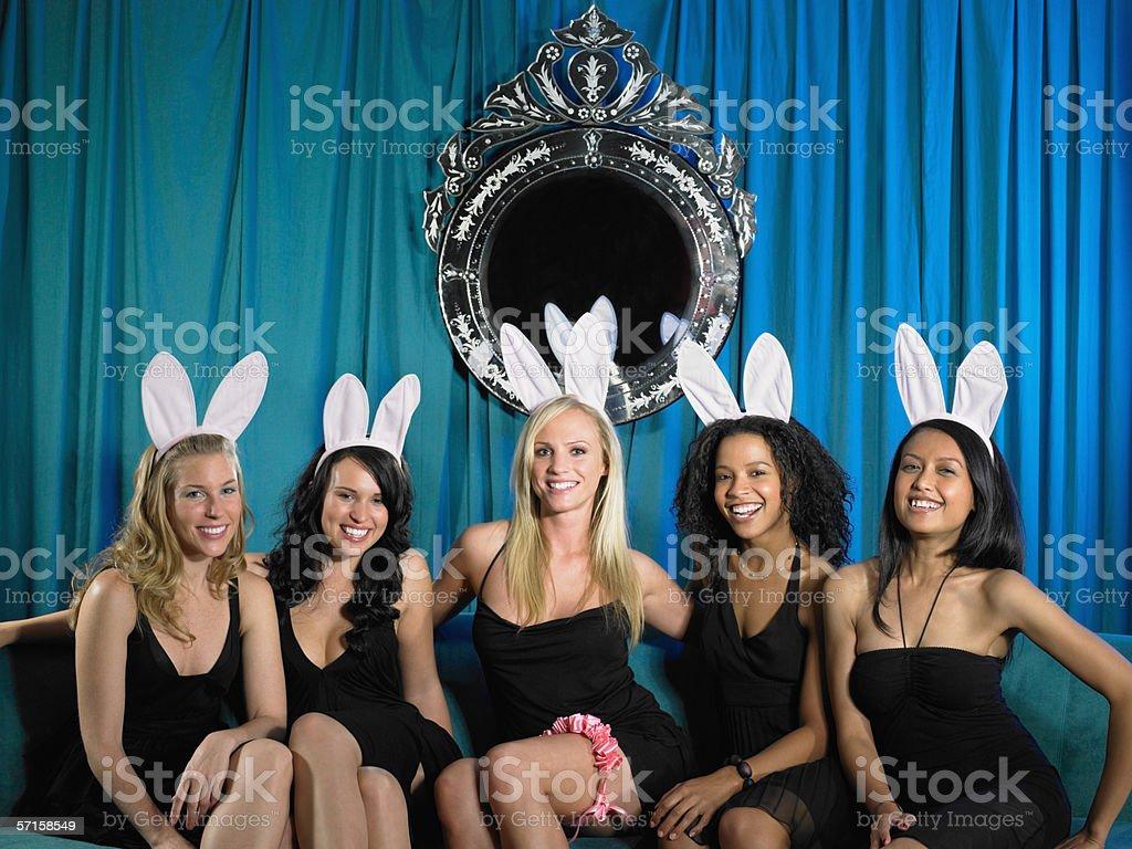Five women sitting in bar stock photo