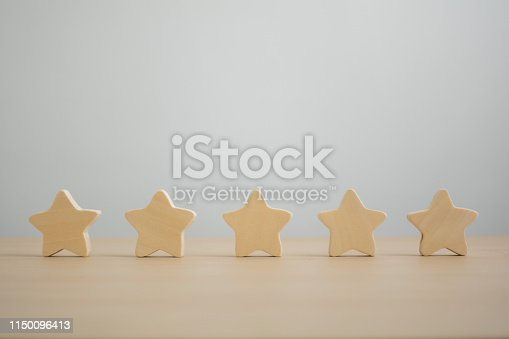 Five wooden stars. Get the fifth star. The concept of the rating of hotels and restaurants, the evaluation of critics and visitors. Quality level, good service.
