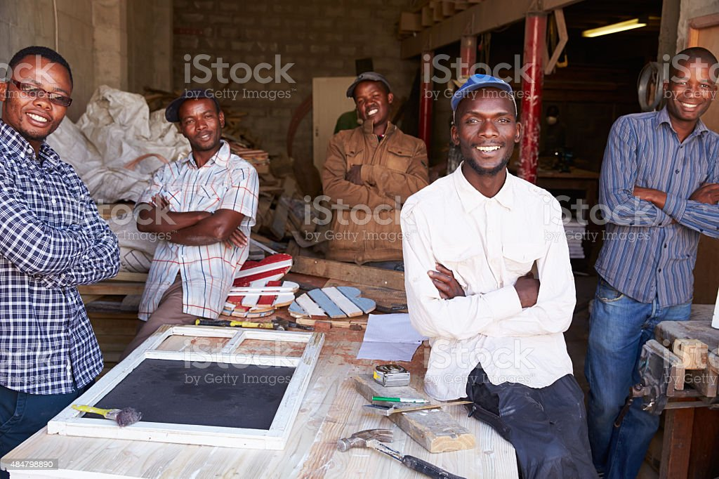 Five workers in a carpentry workshop, portrait, South Africa stock photo