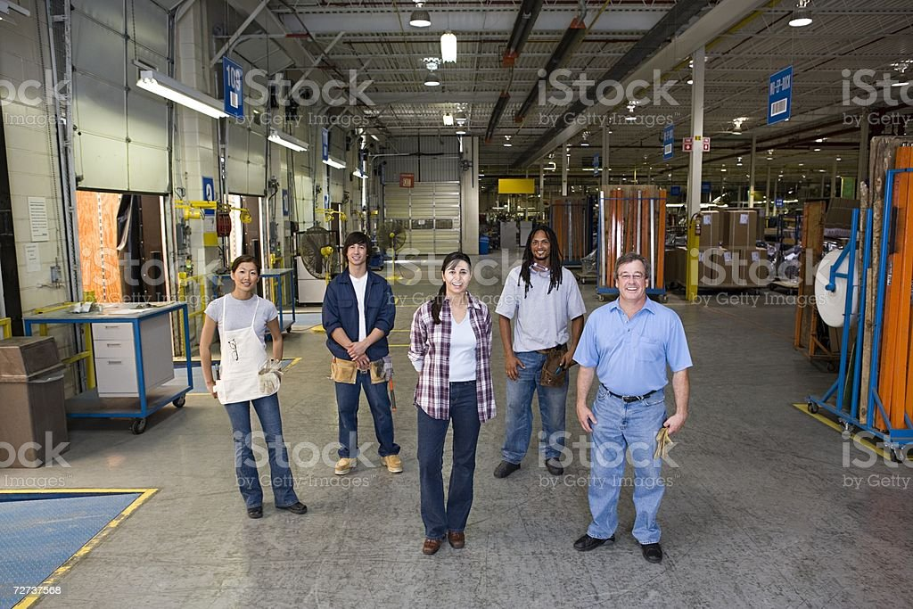 Five workers in a factory stock photo