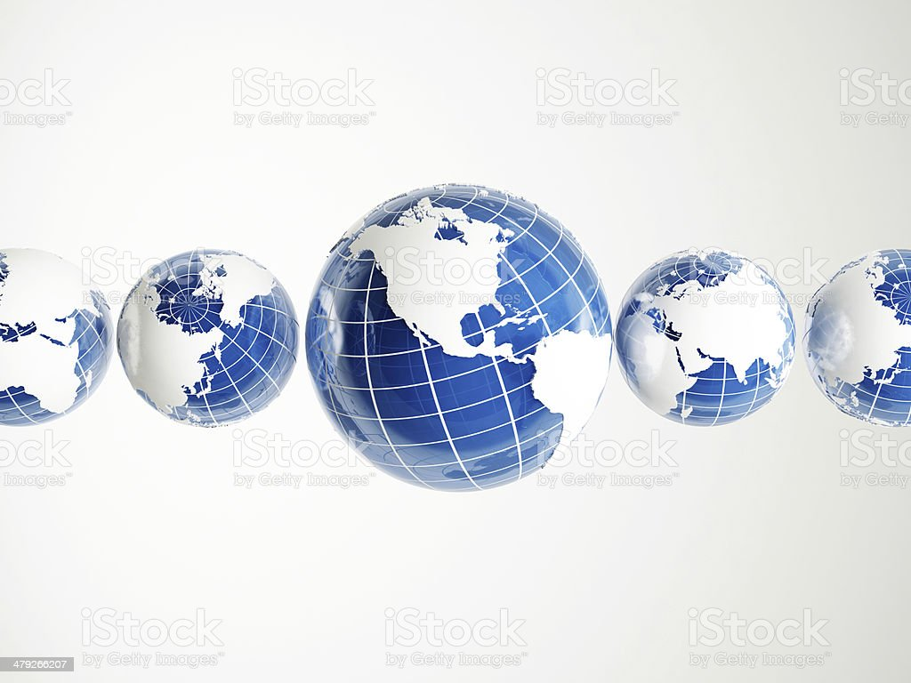 Five world globes in a row royalty-free stock photo