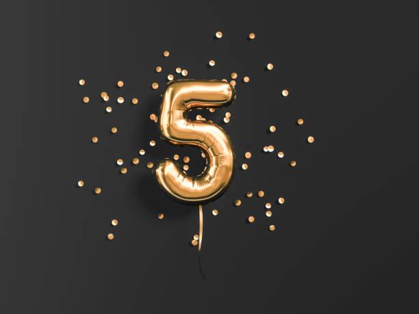 five year birthday. number 5 flying foil balloon - rocznica zdjęcia i obrazy z banku zdjęć