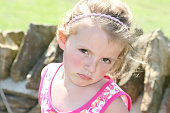 Five year old girl having a grumpy moment.