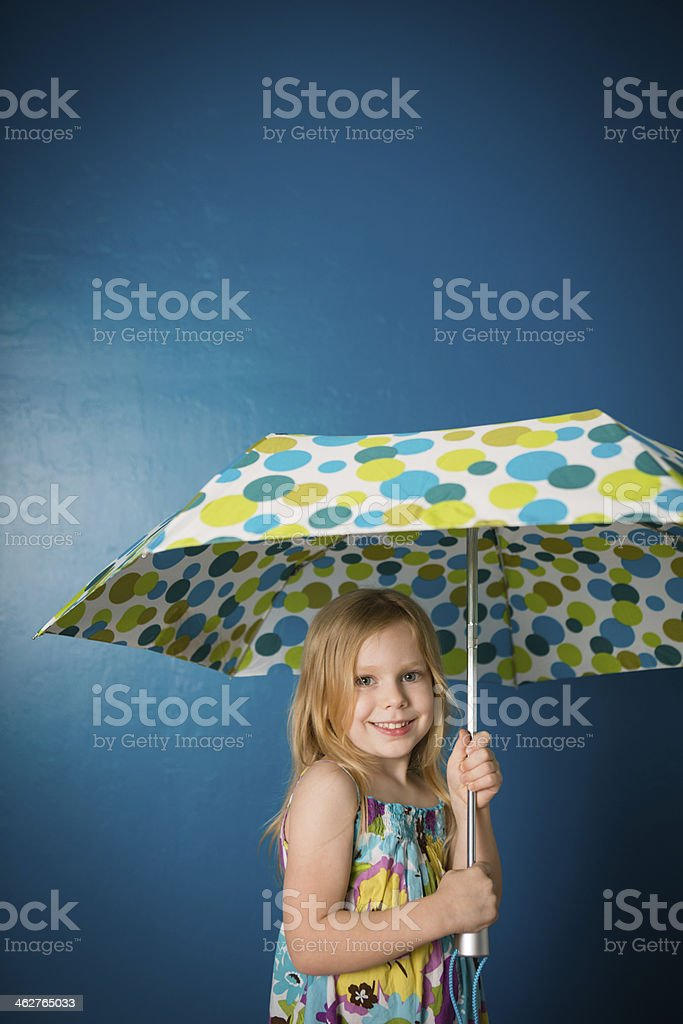 Five Year Old Girl Holding Umbrella, With Copy Space royalty-free stock photo
