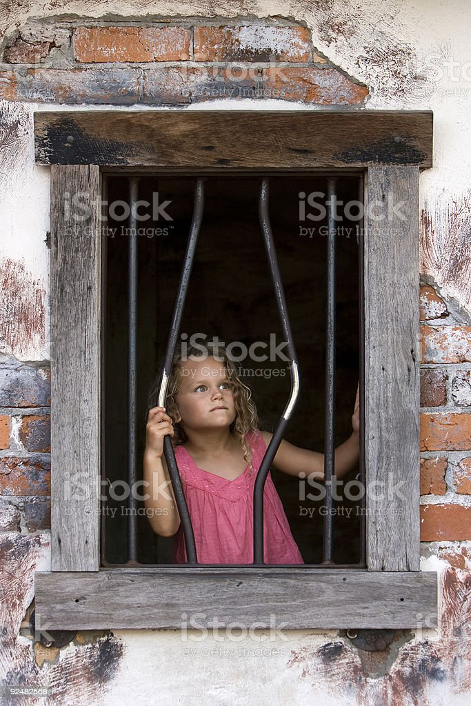 Five year old girl in jail royalty-free stock photo