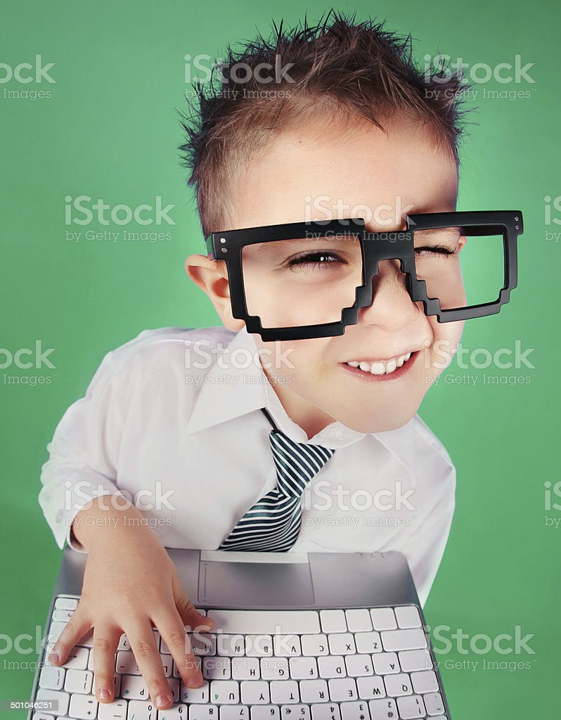 Five years old boy with a laptop computer stock photo