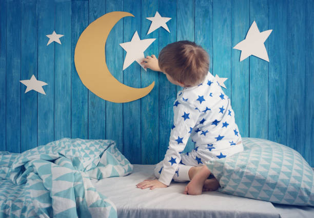 Five years old child sleeping in bed stock photo