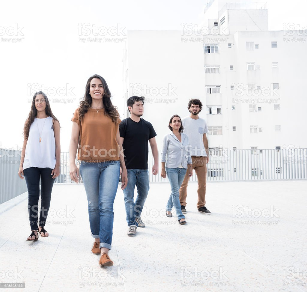 Five young adults on rooftop – Foto