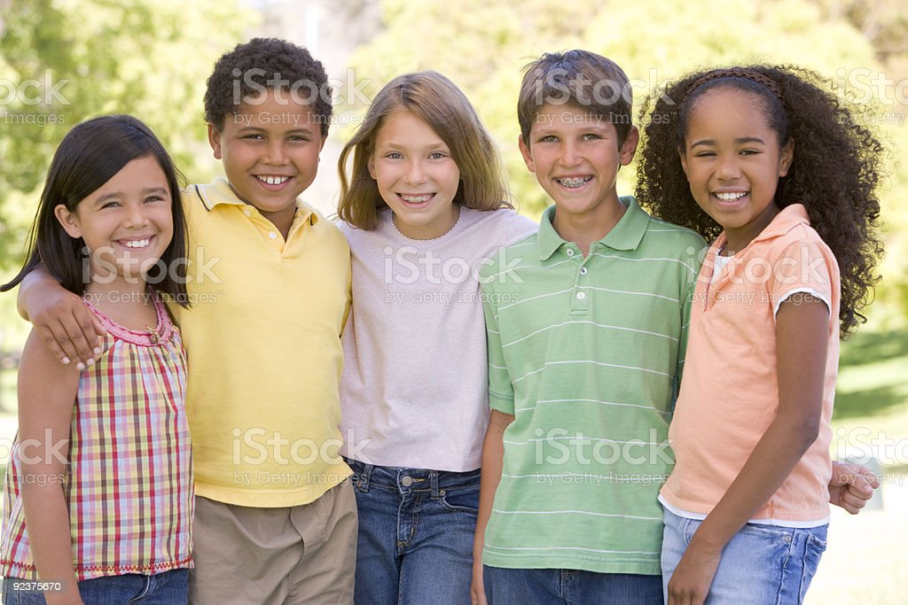 Five young friends standing outdoors royalty-free stock photo