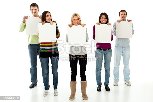 Five young smiling people holding blank boards in front of them.