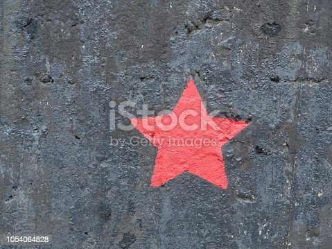 five-pointed red star on a black background