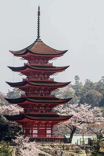 Five-story pagoda in the spring Hatsukaichi, Hiroshima Prefecture, Japan- April 12, 2012: Five-story pagoda in the spring, a UNESCO World Heritage Site Itsukushima Shrine. pagoda stock pictures, royalty-free photos & images