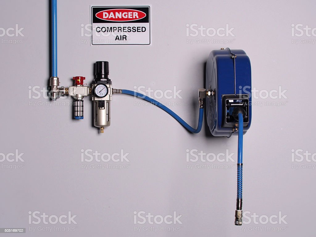 Fixed color coded compressed air line with pressure regulator stock photo