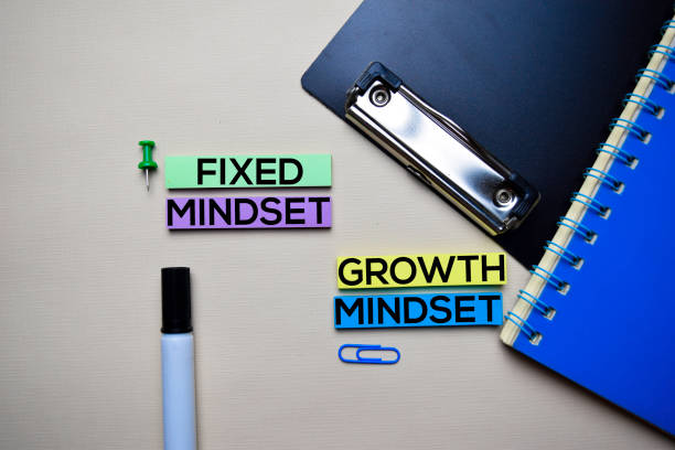 Fixed Mindset or Growth Mindset text on sticky notes with office desk concept stock photo