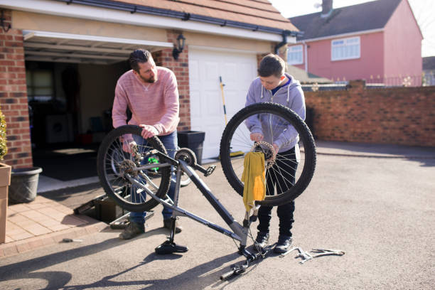 fixing a bike at home - day in the life series stock pictures, royalty-free photos & images