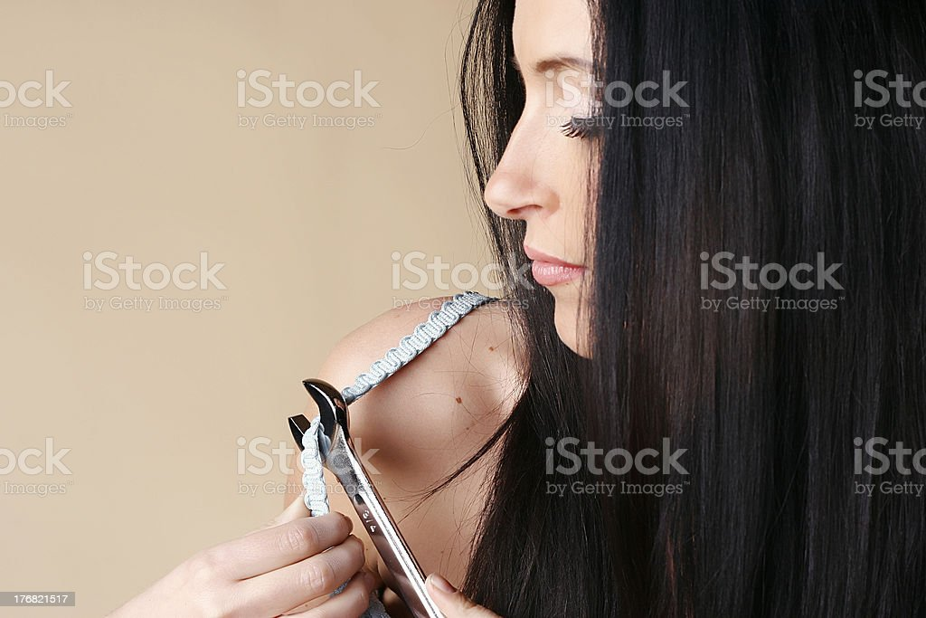 fixing a bra royalty-free stock photo
