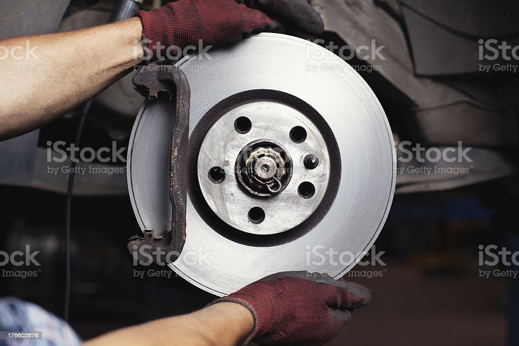 Fixing a broken car brake one step at a time stock photo