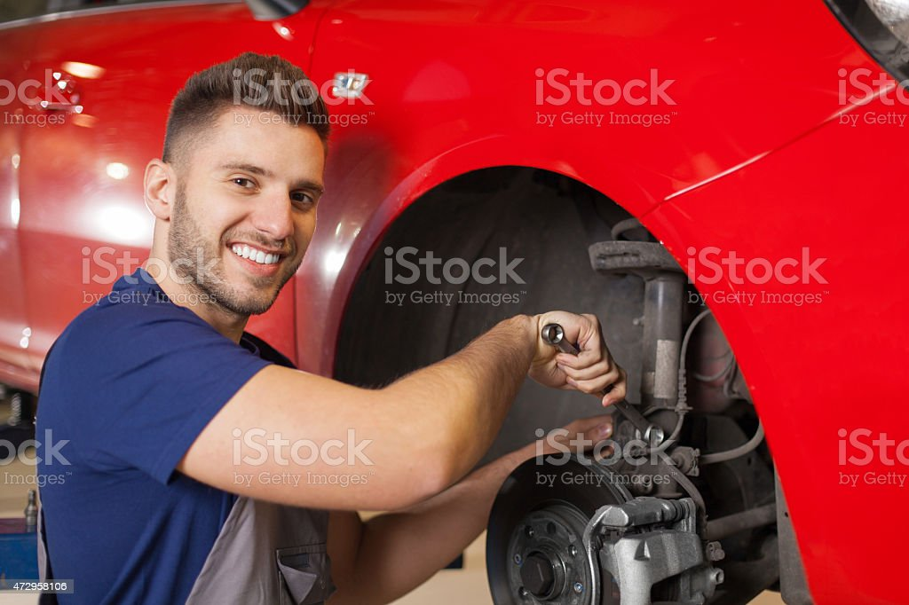 Fixing a Car Suspension stock photo