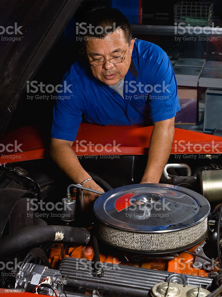 Fixing a classic car royalty-free stock photo