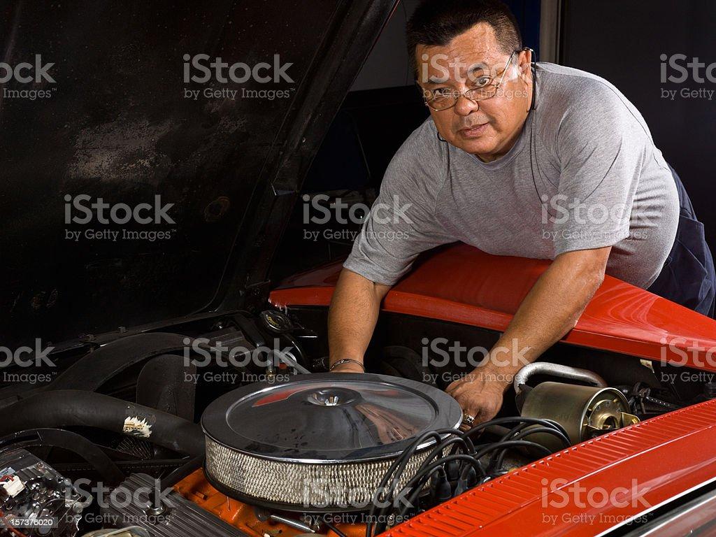 Fixing a classic Corvette royalty-free stock photo