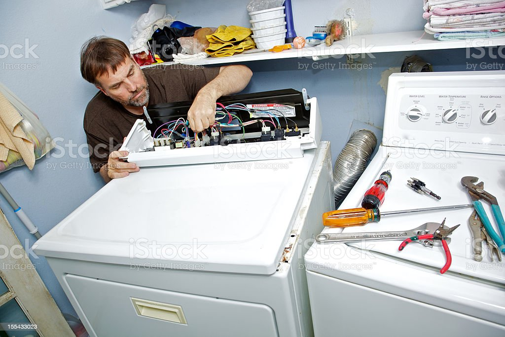 Fixing a Clothes Dryer stock photo