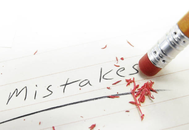 Fixing a mistake Pencil eraser correcting a mistake on paper mistake stock pictures, royalty-free photos & images