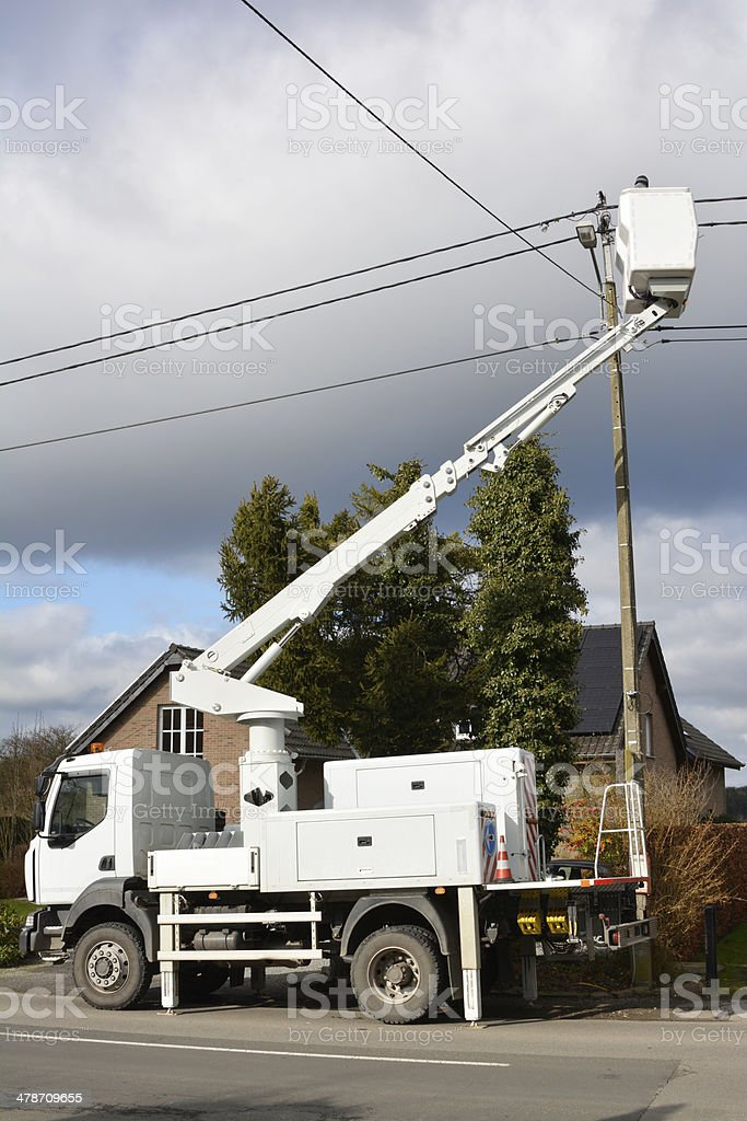 Fixing a power line stock photo
