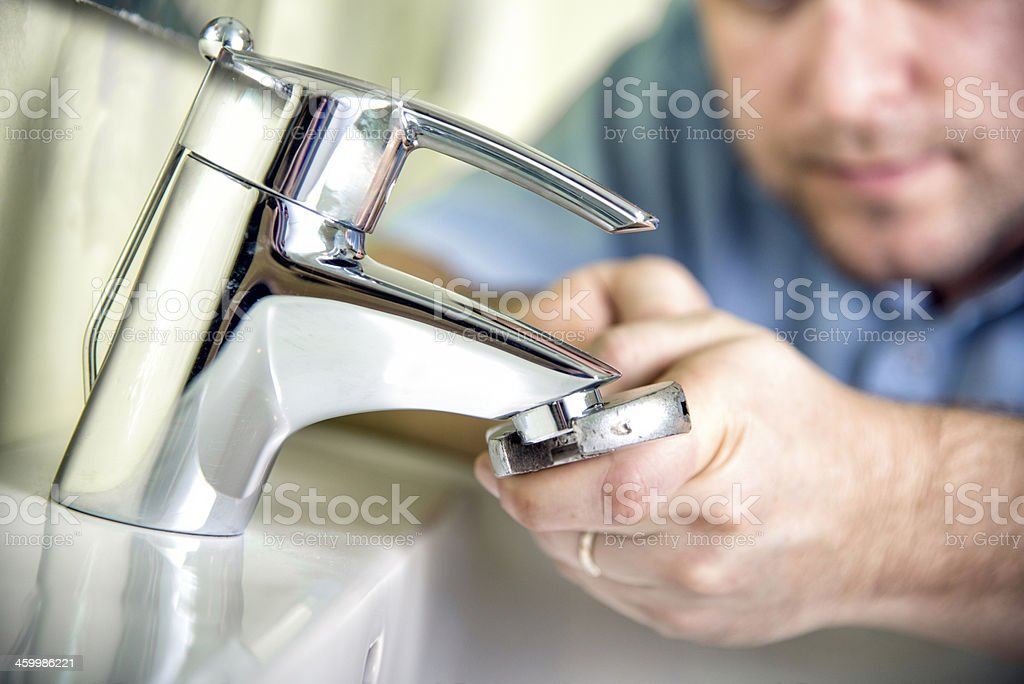 Fixing a tap stock photo