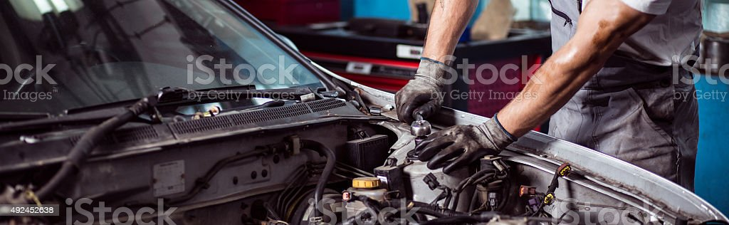 Fixing automotive engine stock photo