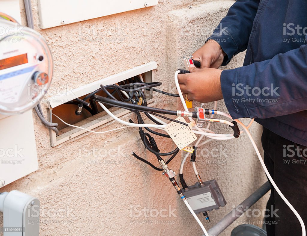 Fixing Cable TV stock photo