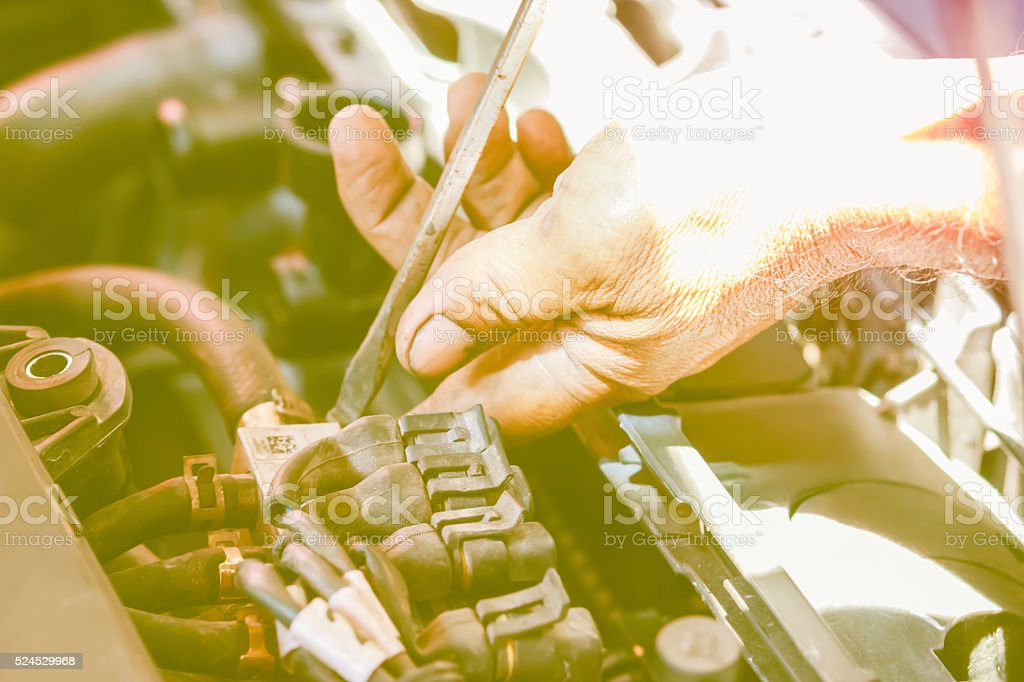 Fixing car hands with tools in vintage style stock photo
