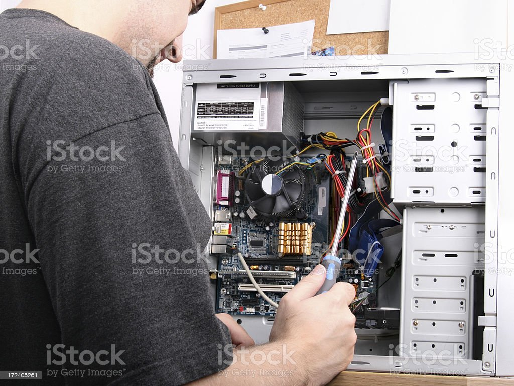 Fixing computer royalty-free stock photo