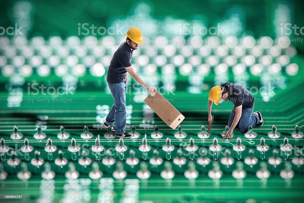 Fixing computers stock photo