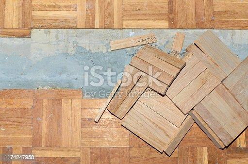 1164292968 istock photo Fixing damaged parquet 1174247958