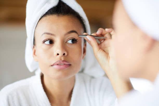 Fixing Eyebrows stock photo