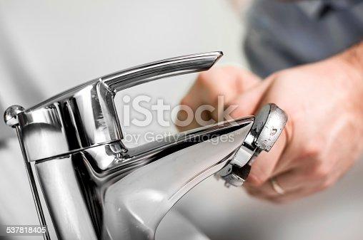 Man fixing water pipe.