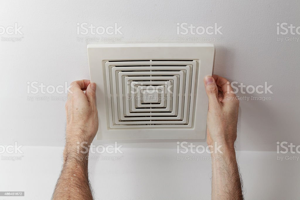 Fixing the air duct stock photo
